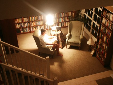 Dr. Beisner reading in his home library where he and his wife Debby have approx. 16,000 volumes.